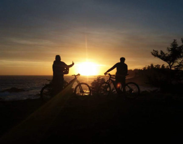 Picture of people biking at sunset